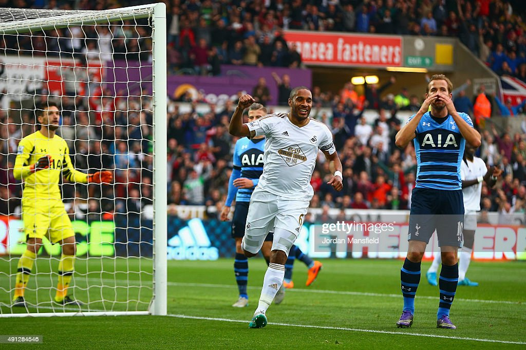 Ashley Williams of Swansea City celebrates after Harry Kane of Tottenham Hotspur scores an own goal during the Barclays Premier League match between Swansea City and Tottenham Hotspur at Liberty Stadium on October 4, 2015 in Swansea, Wales.