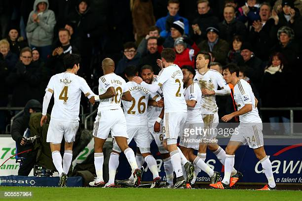 Ashley Williams of Swansea City celebrates with teammates after scoring the opening goal during the Barclays Premier League match between Swansea...