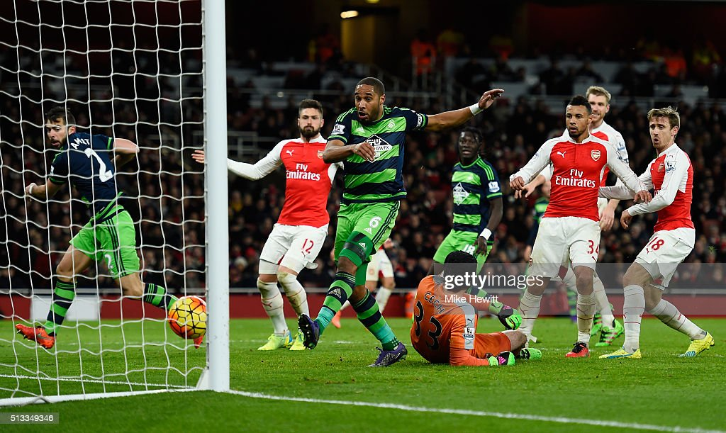 Ashley Williams of Swansea City (c) scores his sides second goal past Petr Cech goalkeeper of Arsenal during the Barclays Premier League match between Arsenal and Swansea City at the Emirates Stadium on March 2, 2016 in London, England.
