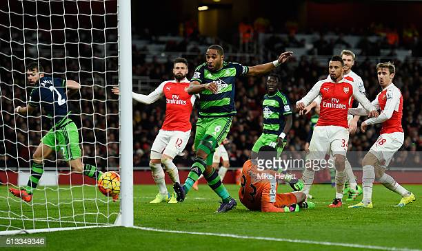 Ashley Williams of Swansea City scores his sides second goal past Petr Cech goalkeeper of Arsenal during the Barclays Premier League match between...