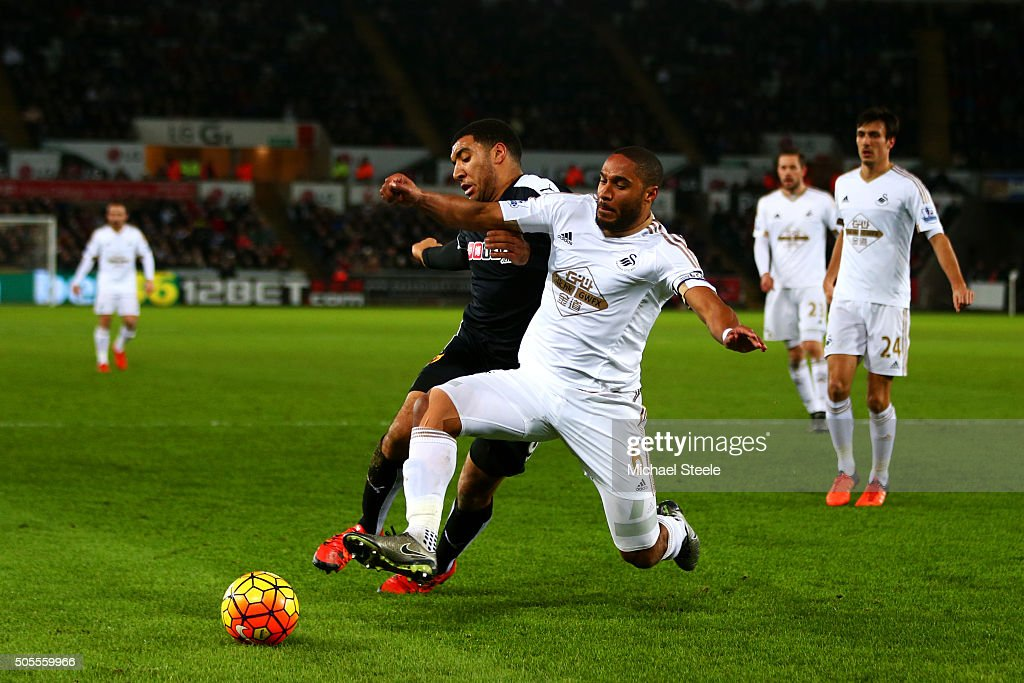 Ashley Williams of Swansea City wins the ball from Troy Deeney of Watford during the Barclays Premier League match between Swansea City and Watford at Liberty Stadium on January 18, 2016 in Swansea, Wales.