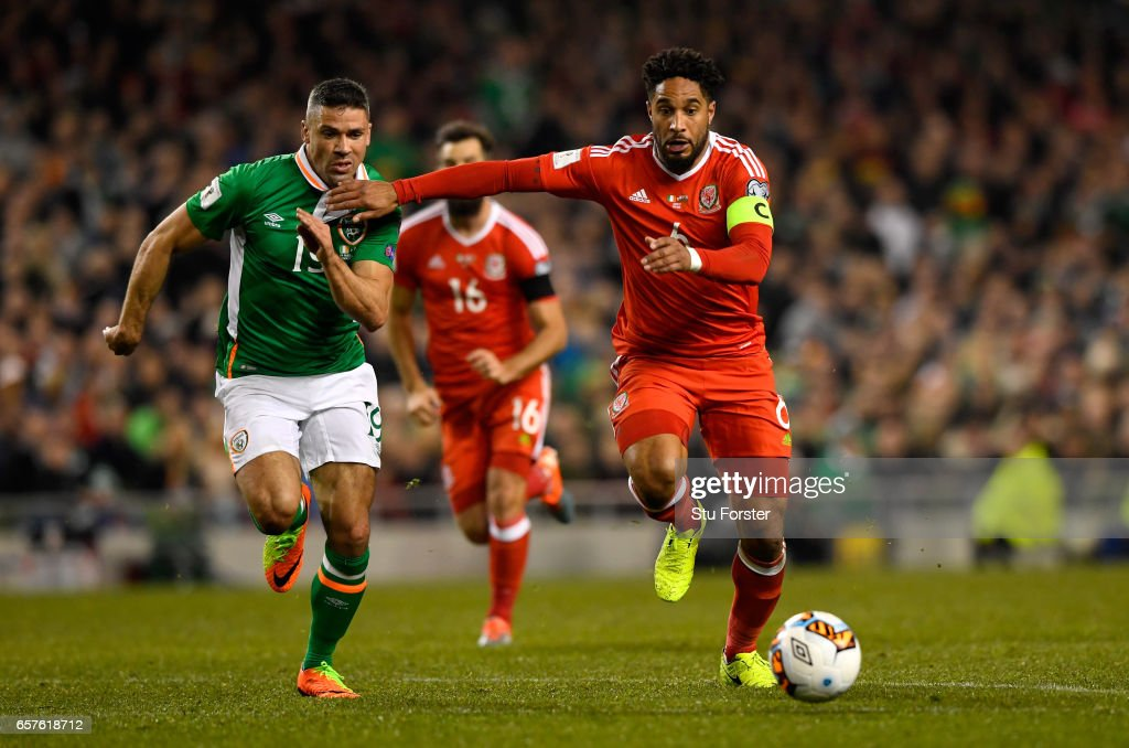 Ashley Williams of Wales and Jonathan Walters of Ireland compete for a ball during the FIFA 2018 World Cup Qualifier between Republic of Ireland and Wales at Aviva Stadium on March 24, 2017 in Dublin, Ireland.