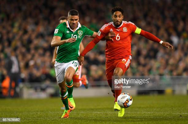 Ashley Williams of Wales and Jonathan Walters of Ireland compete for a ball during the FIFA 2018 World Cup Qualifier between Republic of Ireland and...