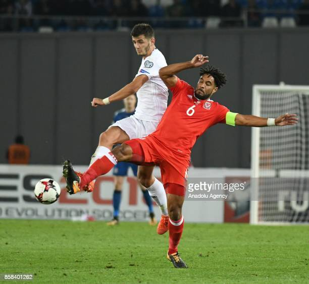 Ashley Williams of Wales in action against Giorgi Kvilitaia of Georgia during the FIFA 2018 World Cup Qualifier between Georgia and Wales at Boris...
