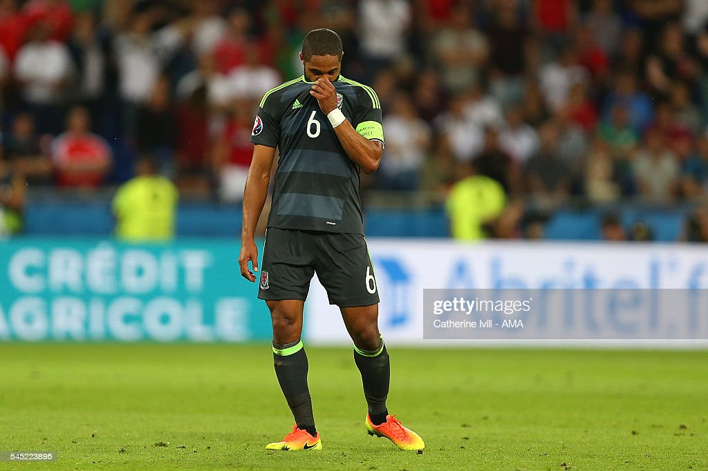 Ashley Williams of Wales looks dejected at the end of the UEFA Euro 2016 Semi Final match between Portugal and Wales at Stade des Lumieres on July 6, 2016 in Lyon, France.