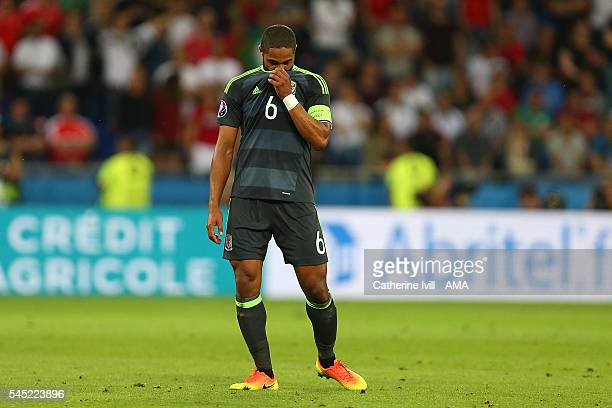 Ashley Williams of Wales looks dejected at the end of the UEFA Euro 2016 Semi Final match between Portugal and Wales at Stade des Lumieres on July 6...