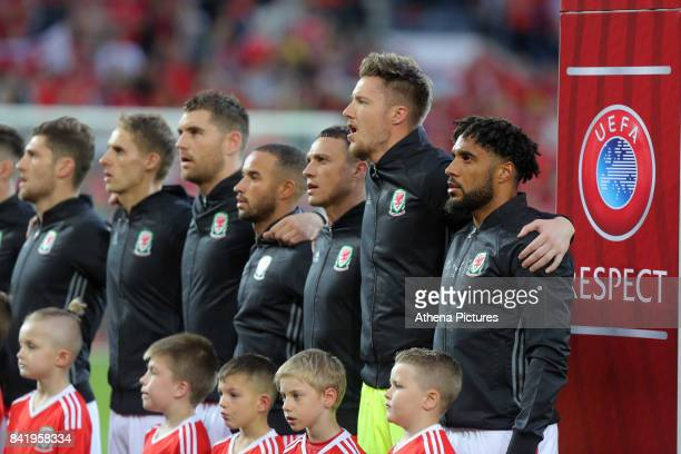 Ashley Williams of Wales sings the national anthem with team mates during the FIFA World Cup Qualifier Group D match between Wales and Austria at The...