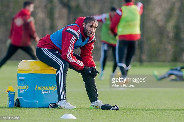 Ashley Williams sits and watches team mates during training on January 28 2015 in Swansea Wales