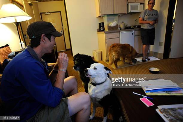 Ashley Woods left gives treats to two of her dogs Olivia and Hudson as her girlfriend Lisa Polansky tends to dog number 3 Aspen while they all get...
