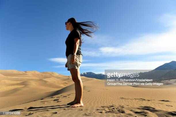 Ashley Woods watches her family as they hike towards the top of the dunes at the Great Sand Dunes on June 20 2019 in Mosca Colorado Great Sand Dunes...
