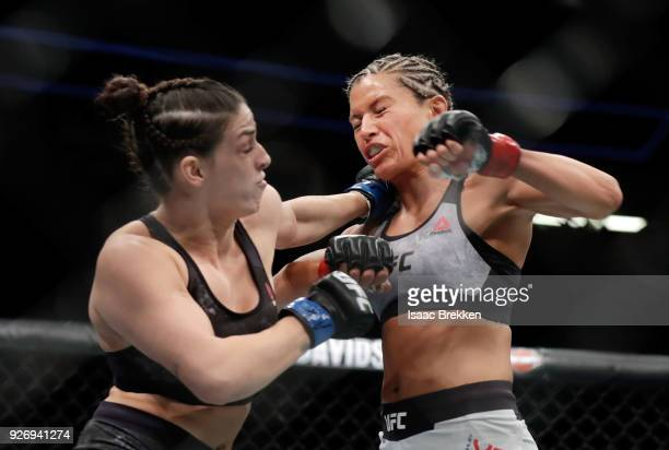 Ashley Yoder and Mackenzie Dern trade punches during their women's strawweight bout during UFC 222 at TMobile Arena on March 3 2018 in Las Vegas...