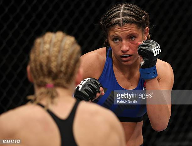 Ashley Yoder battles Justine Kish of Russia in their womens strawweight bout during the UFC Fight Night event at the Times Union Center on December 9...