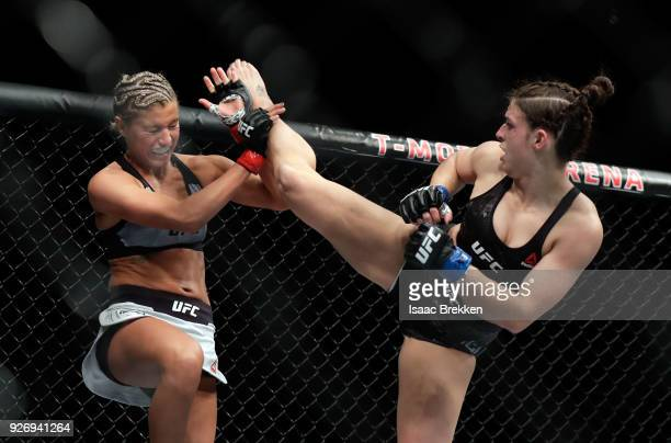 Ashley Yoder blocks a kick from Mackenzie Dern during their women's strawweight bout during UFC 222 at TMobile Arena on March 3 2018 in Las Vegas...