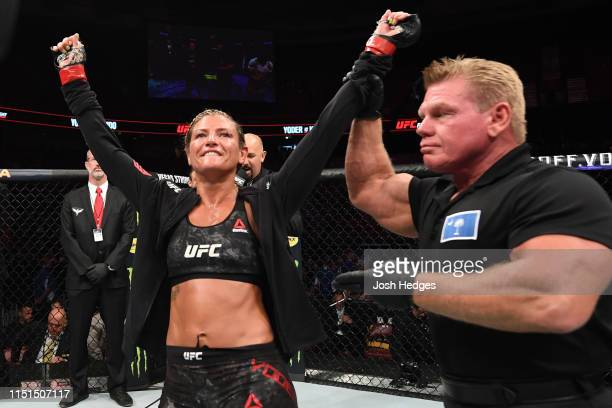Ashley Yoder celebrates her victory over Syuri Kondo of Japan in their women's strawweight bout during the UFC Fight Night event at Bon Secours...