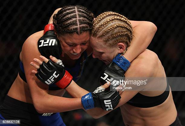 Ashley Yoder grapples with Justine Kish of Russia in their womens strawweight bout during the UFC Fight Night event at the Times Union Center on...
