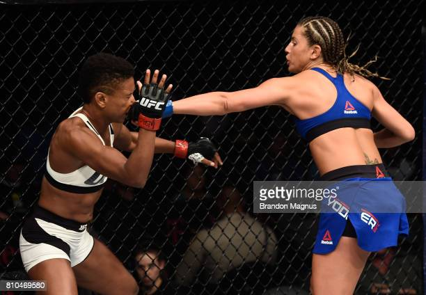 Ashley Yoder punches Angela Hill in their women's strawweight bout during The Ultimate Fighter Finale at TMobile Arena on July 7 2017 in Las Vegas...