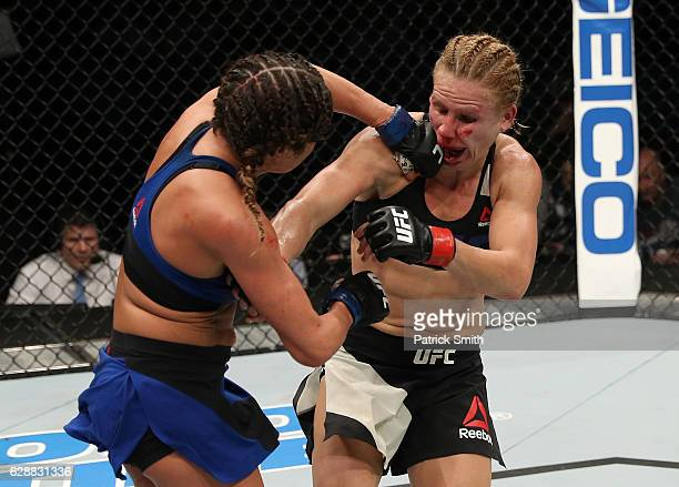 Ashley Yoder punches Justine Kish of Russia in their womens strawweight bout during the UFC Fight Night event at the Times Union Center on December 9...