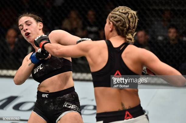 Ashley Yoder punches Mackenzie Dern in their women's strawweight bout during the UFC 222 event inside TMobile Arena on March 3 2018 in Las Vegas...