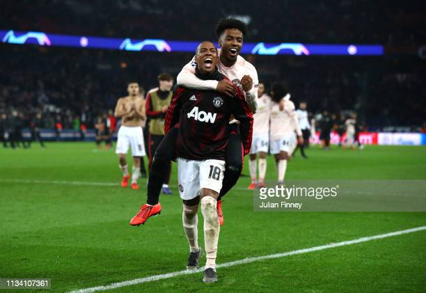 Ashley Young and Angel Gomes of Manchester United celebrate victory during the UEFA Champions League Round of 16 Second Leg match between Paris...