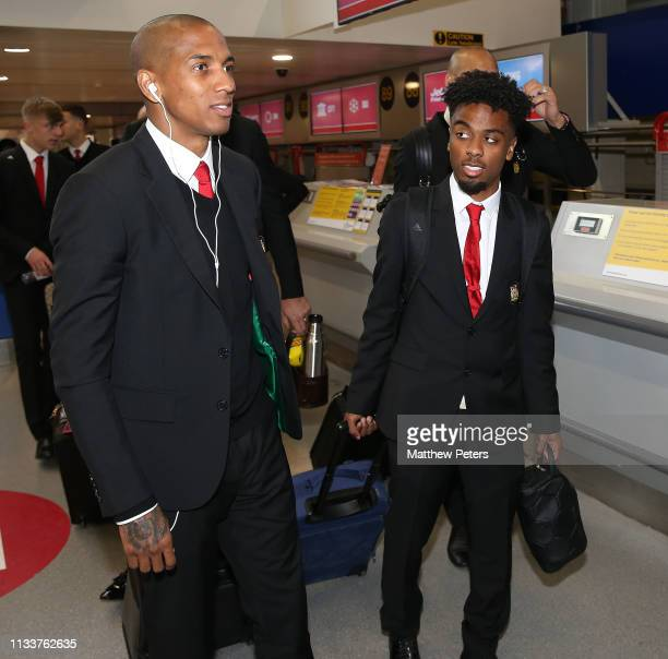 Ashley Young and Angel Gomes of Manchester United check in ahead of the club's flight to Paris for the Champions League match against Paris StGermain...