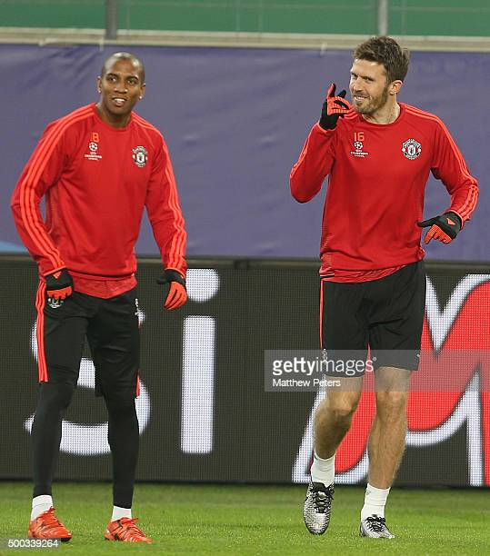 Ashley Young and Michael Carrick of Manchester United in action during a first team training session on the eve of their UEFA Champions League match...