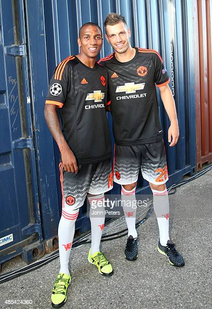 Ashley Young and Morgan Schneiderlin of Manchester United pose at the official launch of the Manchester United third kit in Marseille on August 27...