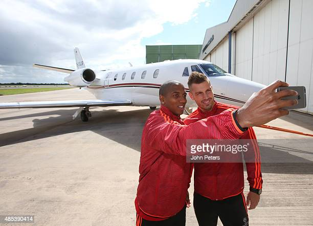 Ashley Young and Morgan Schneiderlin of Manchester United take a selfie in front of a private plane, as they depart for the official launch of the...