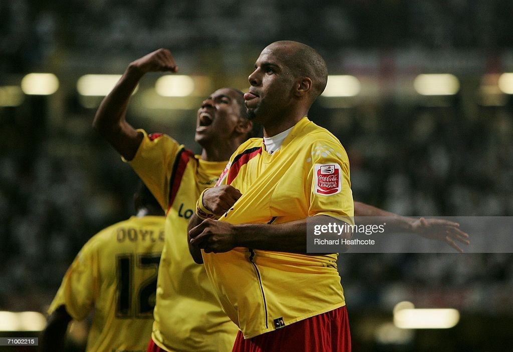 Ashley Young and teammate Marlon King celebrate after Darius Henderson scores their team's third goal during the Coca-Cola Championship Playoff Final between Leeds United and Watford at the Millennium Stadium on May 21, 2006 in Cardiff, Wales.