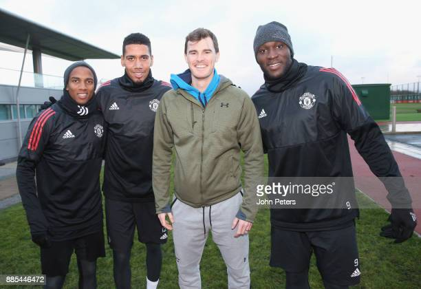 Ashley Young Chris Smalling and Romelu Lukaku of Manchester United pose with tennis player Jamie Murray ahead of a first team training session at Aon...