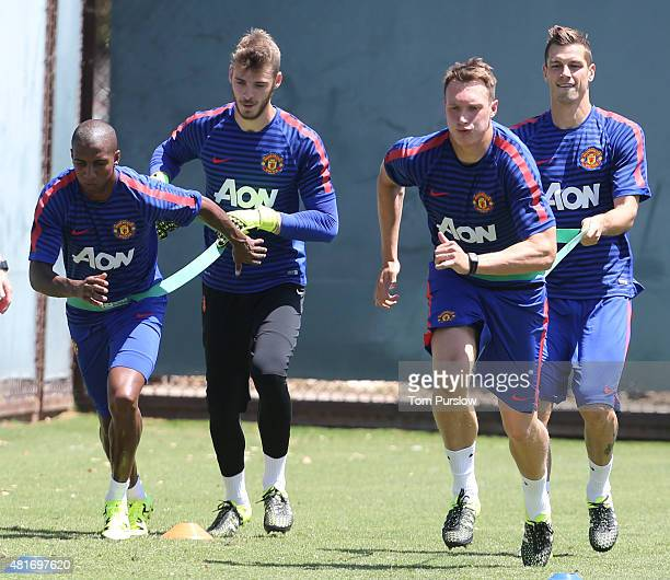 Ashley Young David de Gea Phil Jones and Morgan Schneiderlin of Manchester United in action during a first team training session as part of their...