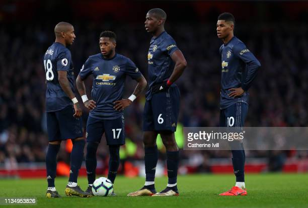 Ashley Young Fred Paul Pogba and Marcus Rashford of Manchester United stand alongside each other during the Premier League match between Arsenal FC...
