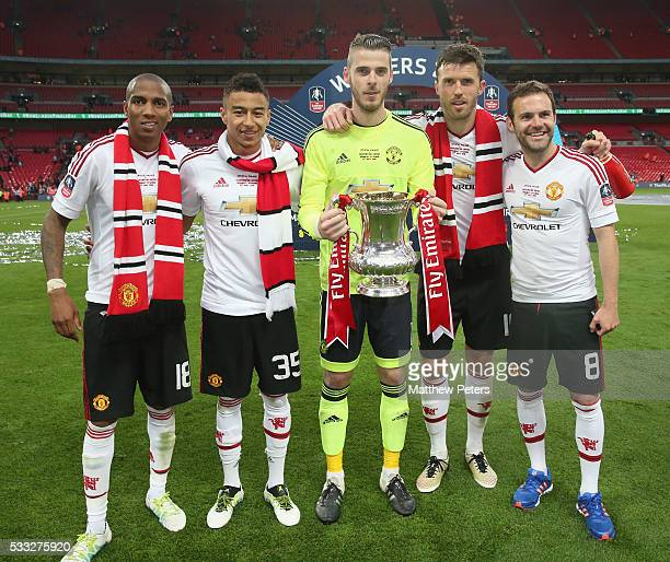 Ashley Young Jesse Lingard David de Gea Michael Carrick and Juan Mata of Manchester United celebrate with the FA Cup trophy after The Emirates FA Cup...