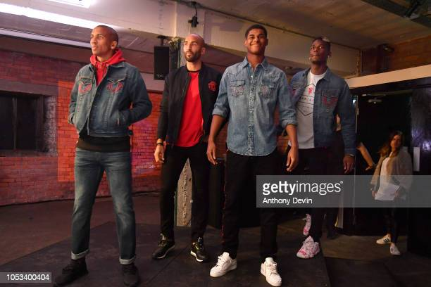 Ashley Young Lee Grant Marcus Rashford and Paul Pogba model True Religion clothing before a question and answer session during the True Religion...