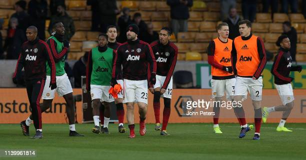 Ashley Young Luke Shaw Chris Smalling Scott McTominay and Victor Lindelof of Manchester United warm up ahead of the Premier League match between...