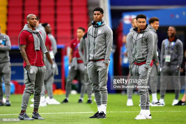 Ashley Young Marcus Rashford and Jesse Lingard all of England look on before the 2018 FIFA World Cup Russia Round of 16 match between Colombia and...