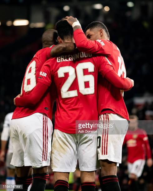 Ashley Young, Mason Greenwood and Marcus Rashford of Manchester United celebrate Ryan Jackson of Colchester United scoring an own goal during the...