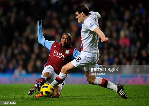 Ashley Young of Aston Villa and former teammate Gareth Barry of Manchester City compete for the ball during the Barclays Premier League match between...