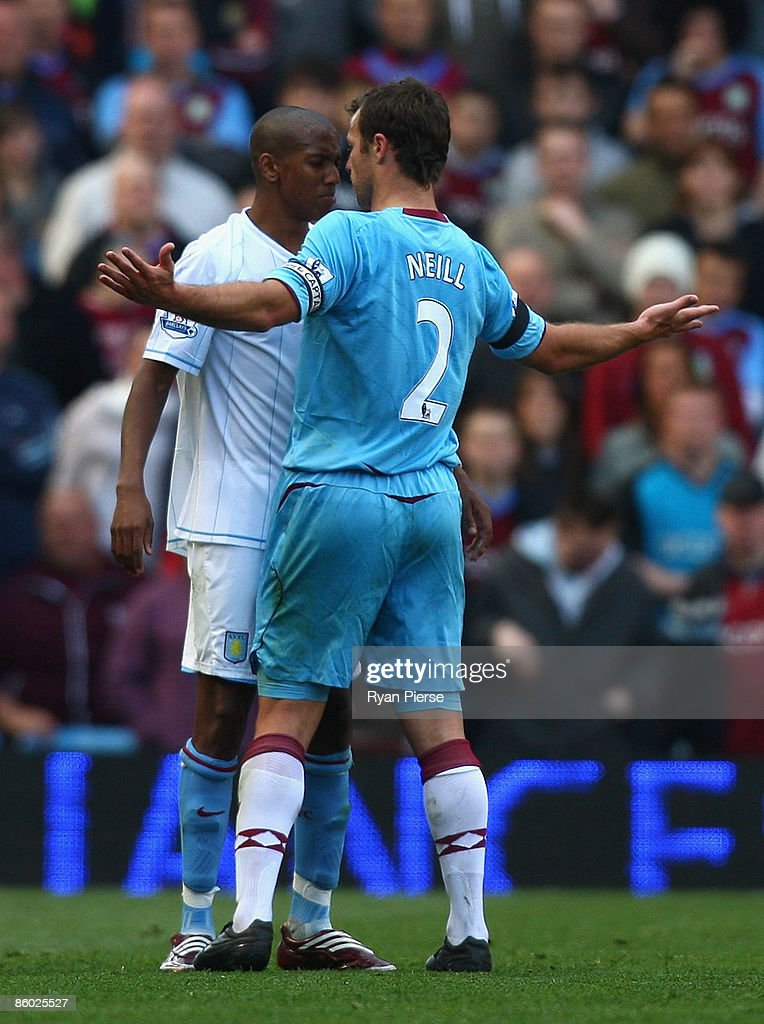 Ashley Young (L) of Aston Villa clashes with Lucas Neill (R) of West Ham during the Barclays Premier League match between Aston Villa and West Ham United at Villa Park on April 18, 2009 in Birmingham, England.