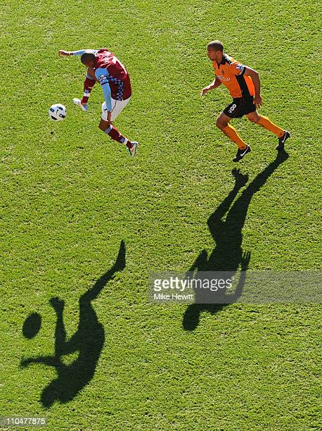 Ashley Young of Aston Villa controls the ball under pressure from Karl Henry of Wolves during the Barclays Premier League match between Aston Villa...
