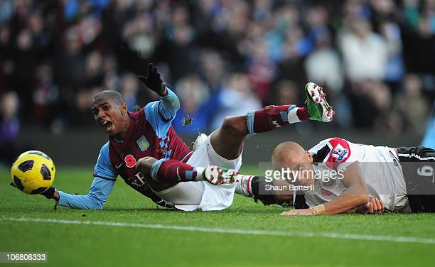 Ashley Young of Aston Villa is bought down by Wes Brown of Manchester United for a penalty during the Barclays Premier League match between Aston...