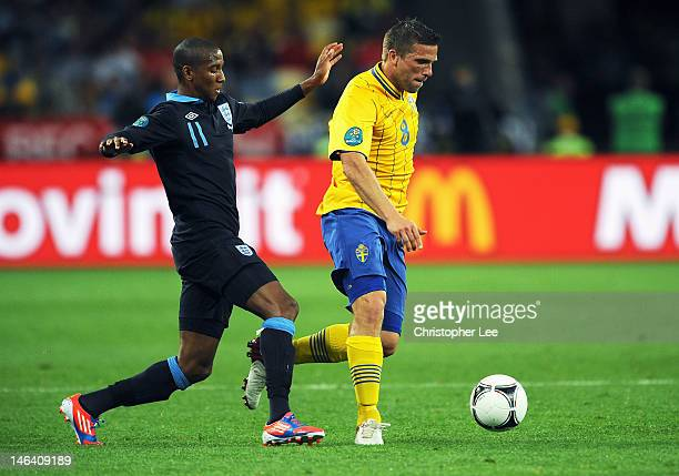 Ashley Young of England and Anders Svensson of Sweden compete for the ball during the UEFA EURO 2012 group D match between Sweden and England at The...