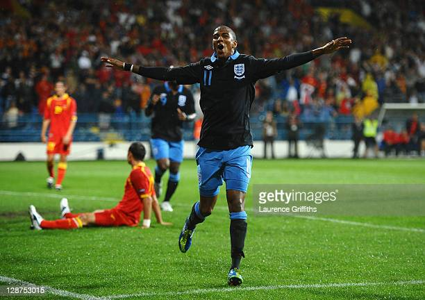 Ashley Young of England celebrates scoring the opening goal during the UEFA EURO 2012 Group G qualifier between Montenegro and England at the City...