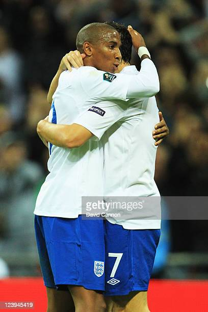 Ashley Young of England celebrates scoring with team mate Gareth Barry during the UEFA EURO 2012 group G qualifying match between England and Wales...