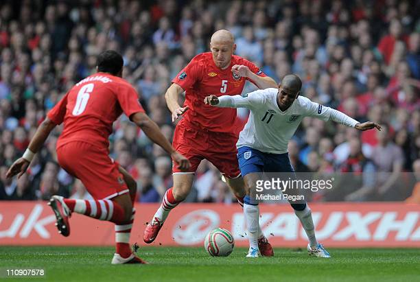 Ashley Young of England is brought down by James Collins of Wales to win a penalty during the UEFA EURO 2012 Group G qualifying match between Wales...