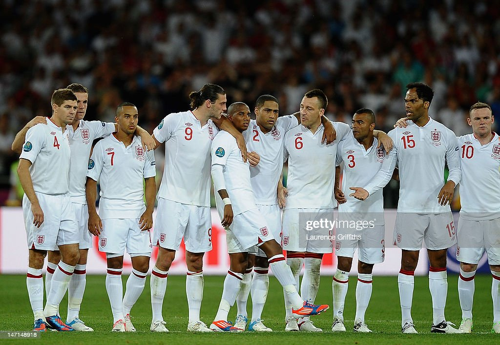 Ashley Young of England is consoled after missing his penalty during the UEFA EURO 2012 quarter final match between England and Italy at The Olympic Stadium on June 24, 2012 in Kiev, Ukraine.
