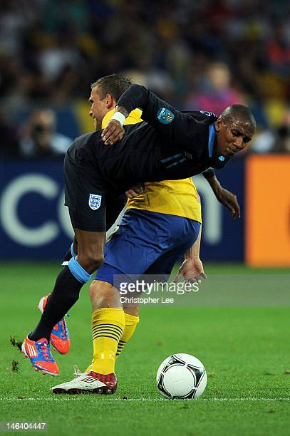 Ashley Young of England is tackled by Anders Svensson of Sweden during the UEFA EURO 2012 group D match between Sweden and England at The Olympic...