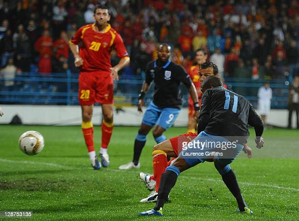 Ashley Young of England scores the team's opening goal during the UEFA EURO 2012 Group G qualifier between Montenegro and England at the City Stadium...
