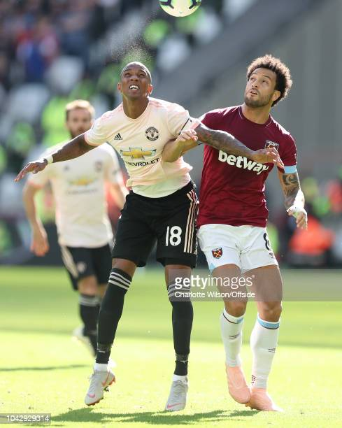 Ashley Young of Man Utd and Felipe Anderson of West Ham look up for the ball during the Premier League match between West Ham United and Manchester...