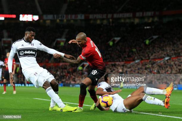 Ashley Young of Man Utd battles with AndreFrank Zambo Anguissa of Fulham and Denis Odoi of Fulham during the Premier League match between Manchester...