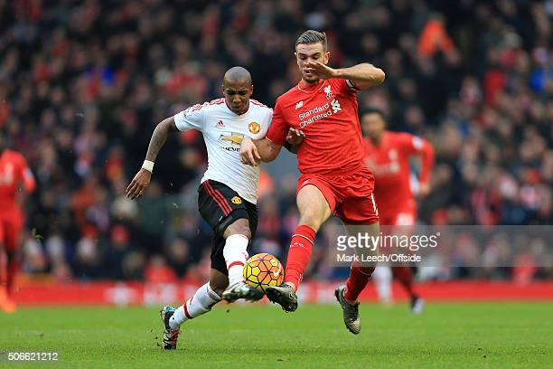 Ashley Young of Man Utd battles with Jordan Henderson of Liverpool during the Barclays Premier League match between Liverpool and Manchester United...
